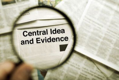 magnifying glass showing the words central idea and evidence