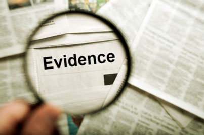 magnifying glass showing the word evidence