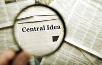 magnifying lens over term central idea