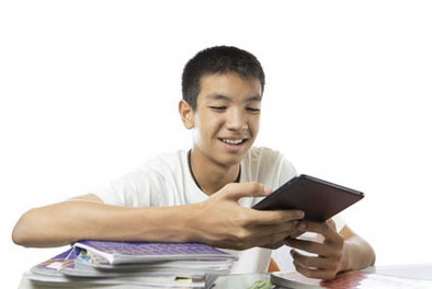 teenager looking at notebooks and tablet device
