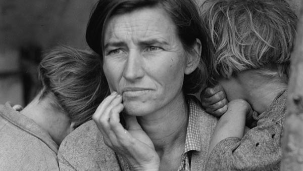black and white close-up photo of a woman holding two children
